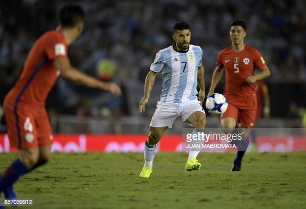 Argentina's Sergio Aguero and Chile's midfielder Francisco Silva vie for the ball during their 2018 FIFA World Cup qualifier football match at the...