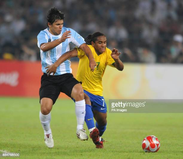 Argentina's Sergio Aguero battles for the ball with Brazil's Anderson in the Semi Final of the Men's Soccer competition at Beijing's Workers Stadium
