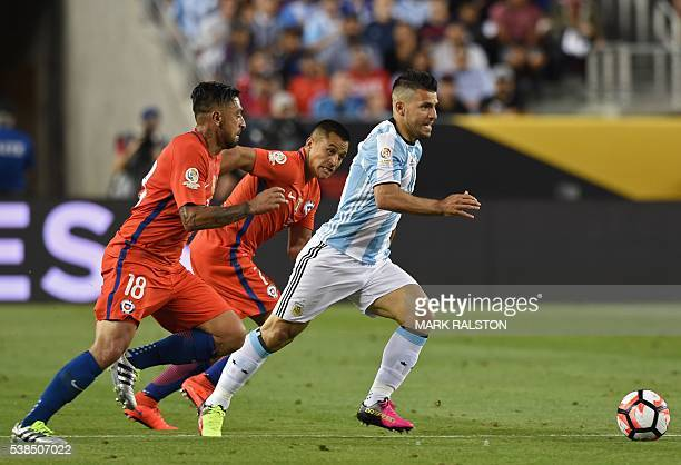 Argentina's Sergio Aguero drives the ball past Chile's Gonzalo Jara and Alexis Sanchez during their Copa America Centenario football tournament match...