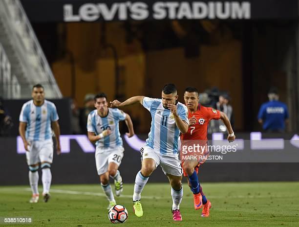 Argentina's Sergio Aguero is followed by Chile's Alexis Sanchez during their Copa America Centenario football tournament match in Santa Clara...