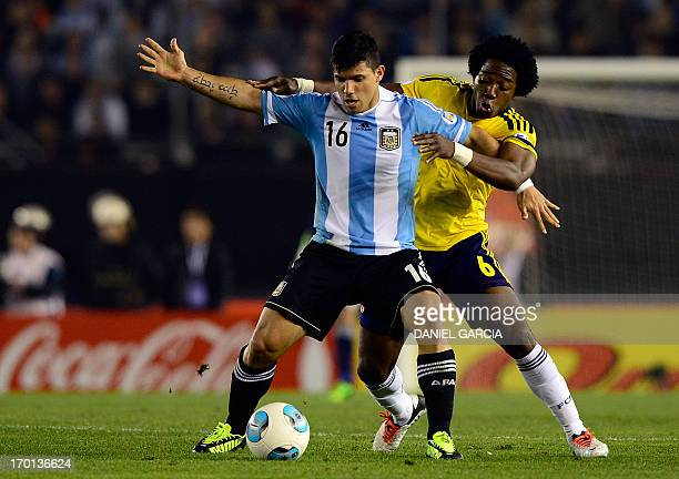 Argentina's Sergio Aguero vies for the ball with Colombia's Carlos Sanchez during their FIFA World Cup Brazil 2014 qualifying match at Monumental...
