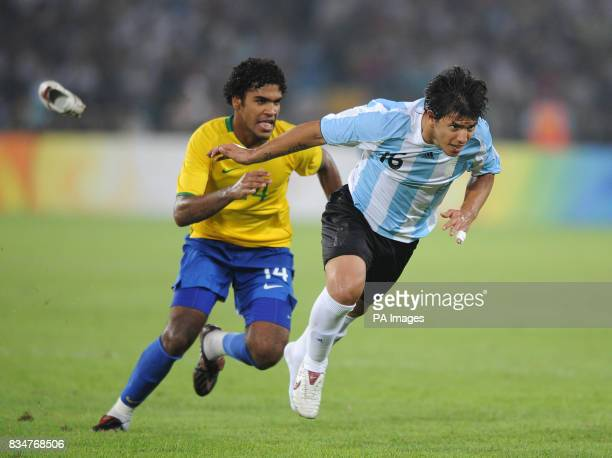Argentina's Sergio Aguero's left boot flies off after a tackle from Brazil's Breno in the Semi Final of the Men's Soccer competition at Beijing's...