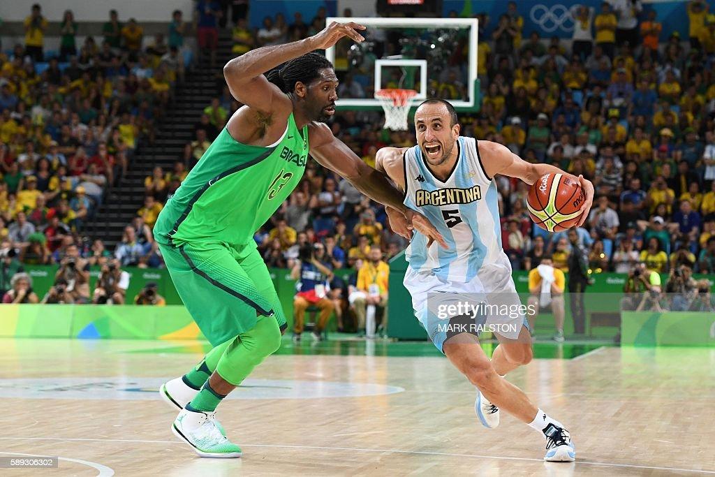 TOPSHOT Argentina's shooting guard Manu Ginobili works around Brazil's centre Nene Hilario during a Men's round Group B basketball match between...
