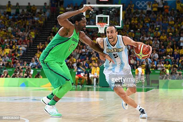 TOPSHOT Argentina's shooting guard Manu Ginobili works around Brazil's centre Nene Hilario during a Men's round Group B basketball match between...