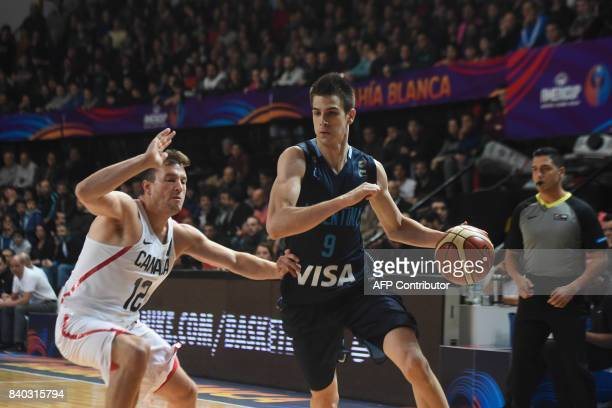 Argentina's shooting guard Nicolas Brussino drives the ball marked by Canada's guard Brady Heslip during their 2017 FIBA Americas Championship Group...