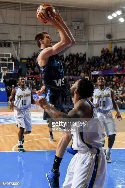 Argentina's shooting guard Nicolas Brussino shoots marked by Virgin Islands point guard Walter Hodge during their 2017 FIBA Americas Championship...