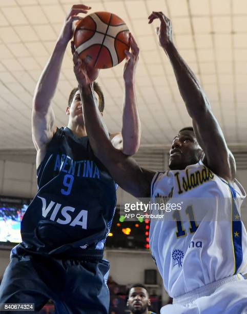 Argentina's shooting guard Nicolas Brussino vies for the ball with Virgin Islands guard Deon Edwin during their 2017 FIBA Americas Championship Group...
