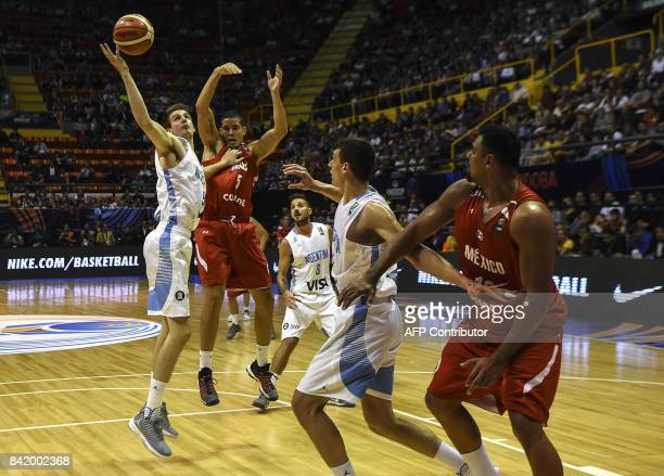 Argentina's shooting guard Nicolas Brussino vies for the ball with Mexico's power forward Irwing Avalos during their 2017 FIBA Americas Championship...