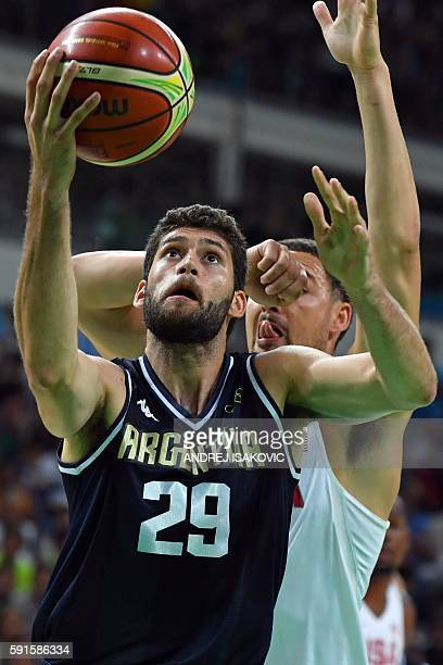 Argentina's shooting guard Patricio Garino goes to the basket past USA's guard Klay Thompson during a Men's quarterfinal basketball match between USA...