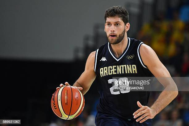 Argentina's shooting guard Patricio Garino runs during a Men's round Group B basketball match between Spain and Argentina at the Carioca Arena 1 in...