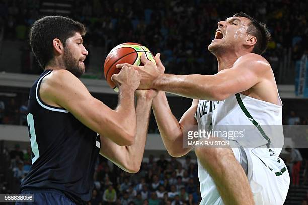 TOPSHOT Argentina's shooting guard Patricio Garino vies with Lithuania's small forward Jonas Maciulis during a Men's round Group B basketball match...