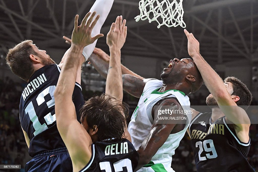 Argentina's small forward Andres Nocioni Argentina's centre Marcos Delia Nigeria's small forward AlFarouq Aminu and Argentina's shooting guard...