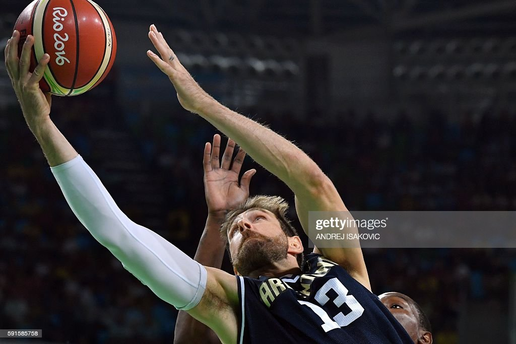 TOPSHOT Argentina's small forward Andres Nocioni goes to the basket during a Men's quarterfinal basketball match between USA and Argentina at the...