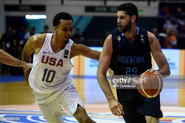 Argentina's small forward Patricio Garino drives the ball marked by USA's shooting guard Reggie Hearn during their 2017 FIBA Americas Championship...