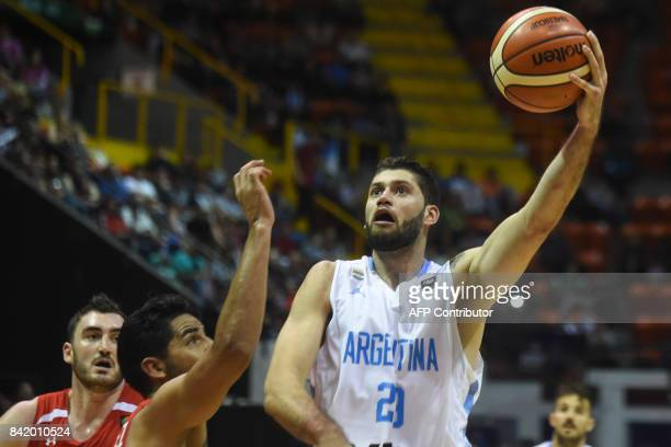Argentina's small forward Patricio Garino shoots against Mexico during their 2017 FIBA Americas Championship semifinals match in Cordoba Argentina on...