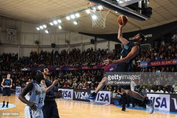 Argentina's small forward Patricio Garino shoots against Virgin Islands during their 2017 FIBA Americas Championship Group B game in Bahia Blanca...
