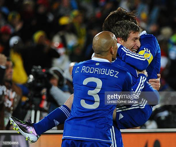 Argentina's striker Martin Palermo celebrates with team mate Argentina's striker Lionel Messi after scoring during the Group B first round 2010 World...
