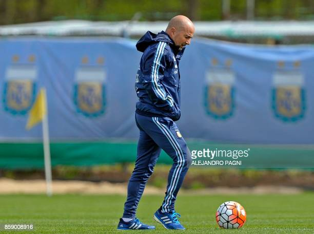 Argentina's team coach Jorge Sampaoli plays with the ball during a training session in Ezeiza Buenos Aires on October 8 2017 ahead of a 2018 FIFA...