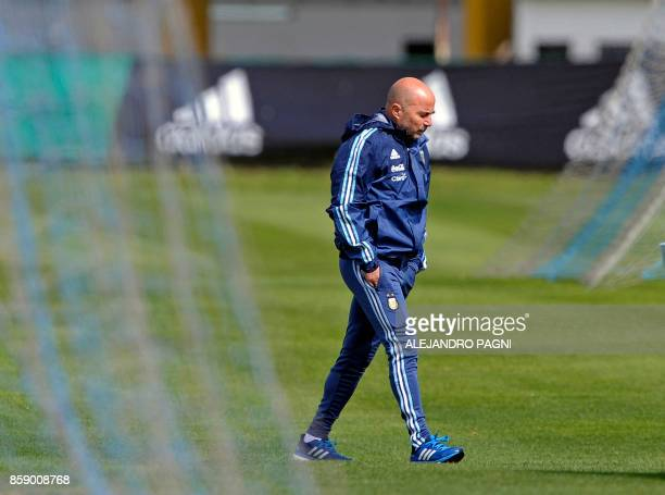 Argentina's team coach Jorge Sampaoli walks on the field during a training session in Ezeiza Buenos Aires on October 8 2017 ahead of a 2018 FIFA...