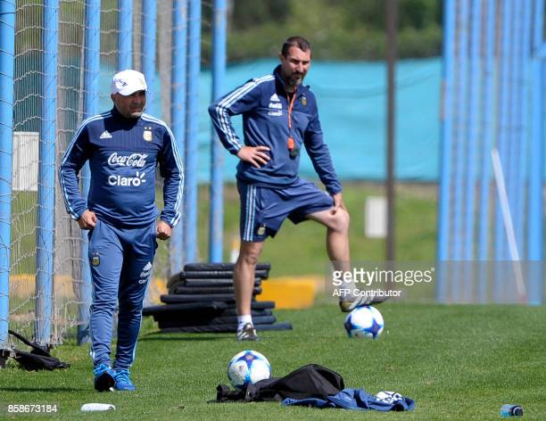 Argentina's team coach Jorge Sampaoli watches his players during a training session in Ezeiza Buenos Aires on October 7 2017 ahead of a 2018 FIFA...