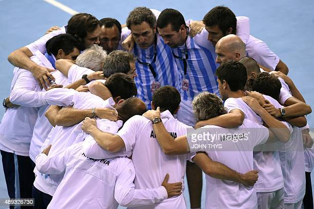 Argentina's team gather during the Davis cup semifinal against Belgian Steve Darcis at the Forest National Arena on September 20 2015 AFP PHOTO/JOHN...