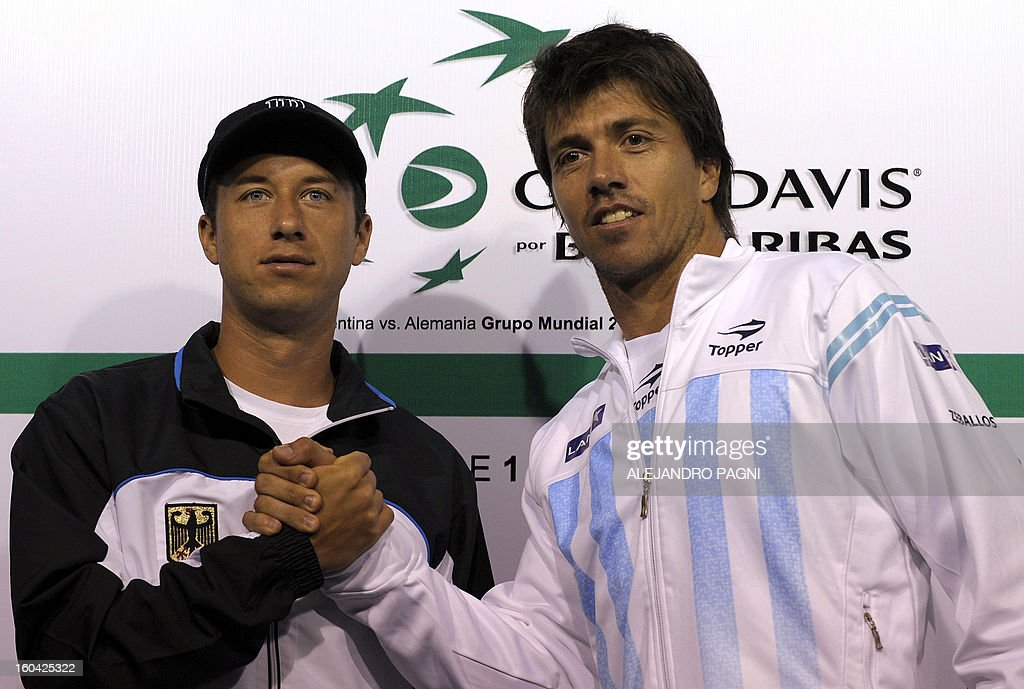 Argentina's tennis player Carlos Berlocq (R) shakes hands with Germany's Philipp Kohlschreiber during the fixture draw at Parque Roca stadium in Buenos Aires, on January 31, 2013. Argentina will face Germany -from Friday on- for the 2013 Davis Cup World Group first round.