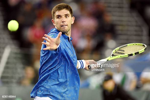 Argentina's tennis player Federico Delbonis returns the ball to Croatia's Ivo Karlovic during the Davis Cup World Group final singles match between...