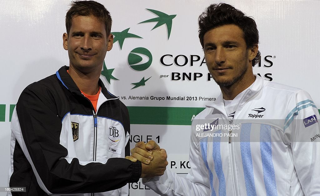 Argentina's tennis player Juan Monaco (R) shakes hands with Germany's Florian Mayer during the fixture draw at Parque Roca stadium in Buenos Aires, on January 31, 2013. Argentina will face Germany -from Friday on- for the 2013 Davis Cup World Group first round.