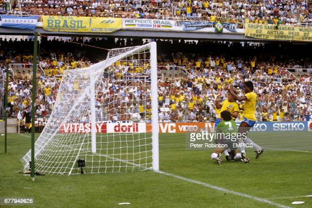 Argentina's Ubaldo Fillol can only look on as Zico scores Brazil's first goal Brazil's Serginho is also in close company