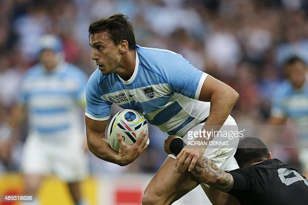 Argentina's wing Juan Imhoff is tackled by New Zealand's scrum half Aaron Smith during a Pool C match of the 2015 Rugby World Cup between New Zealand...