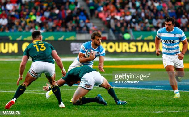 Argentina's winger Ramiro Moyano is tackled during the International Rugby Test match between Argentina and South Africa at The Nelson Mandela Bay...