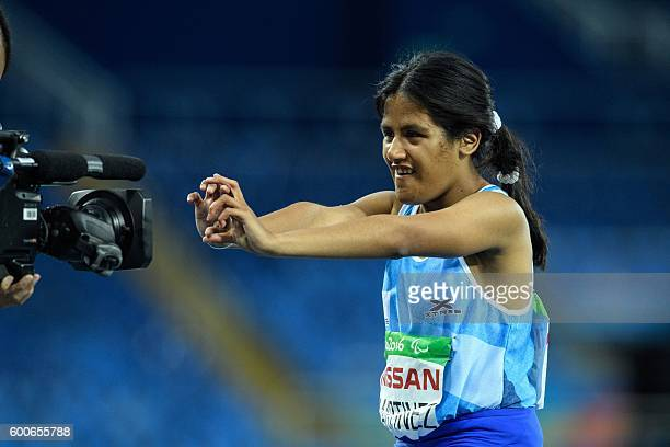 Argentina's Yanina Andrea Martinez reacts to broadcasting camera during a heat of women's 100 m of the Rio 2016 Paralympic Games at Olympic Stadium...