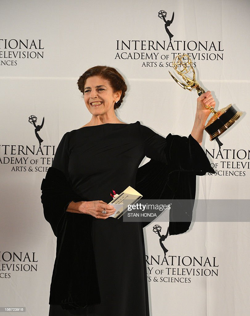 Argentine actress Cristina Banegas holds up her trophy at the 40th International Emmy Awards November 19, 2012 in New York. Banegas won for best performance by an actress in 'Sin Cobertura.' AFP PHOTO/Stan HONDA