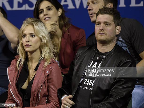 Argentine actress Luisana Lopilato and her housband Canadian singer Michael Buble attend the ATP Argentina Open tennis match between Spanish tennis...