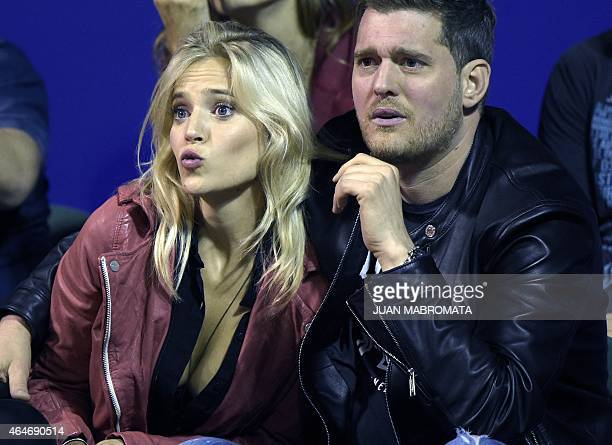 Argentine actress Luisana Lopilato and her housband Canadian singer Michael Buble gesture during the ATP Argentina Open tennis match between Spanish...