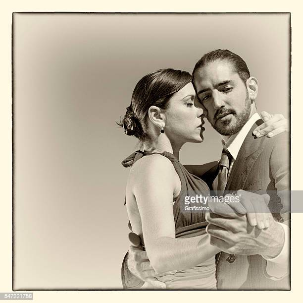 Argentine couple dancing tango in Buenos Aires sepia