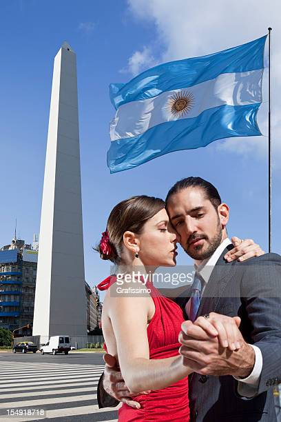 Argentine couple dancing tango in Buenos Aires with Obelisk