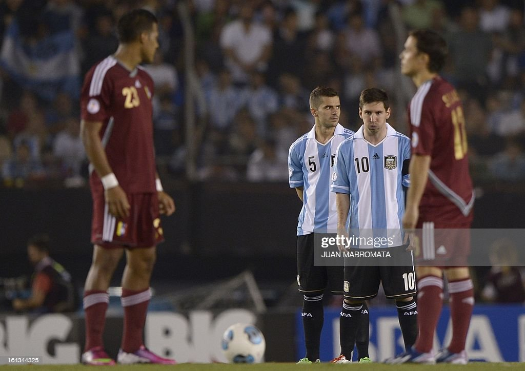 Argentine defender Pablo Zabaleta and forward Lionel Messi are seen during a moment of silence for the late Venzuelan President Hugo Chavez before their FIFA World Cup Brazil 2014 South American qualifying football match against Venezuela in Buenos Aires, Argentina on March 22, 2013.