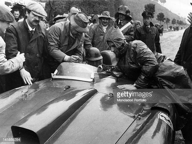 Argentine driver Juan Manuel Fangio behind the wheel of his Ferrari during the Mille Miglia Rome April 1956