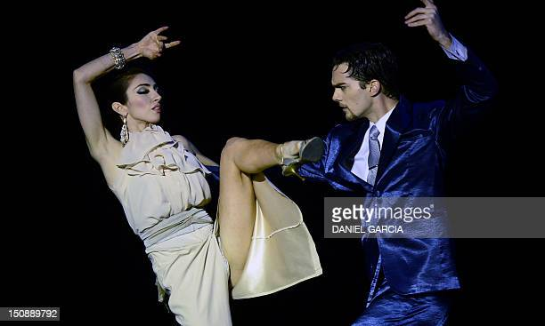 Argentine Eber Alejandro Burger and Yesica Lorena Lozano Elias perform during the Tango World Championship Stage Tango competition in Buenos Aires on...