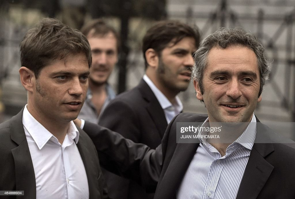 Argentine Economy Minister <a gi-track='captionPersonalityLinkClicked' href=/galleries/search?phrase=Axel+Kicillof&family=editorial&specificpeople=9189054 ng-click='$event.stopPropagation()'>Axel Kicillof</a> (L) and ruling party legislator Andres Larroque gesture after the speech of Argentine President <a gi-track='captionPersonalityLinkClicked' href=/galleries/search?phrase=Cristina+Fernandez+de+Kirchner&family=editorial&specificpeople=565499 ng-click='$event.stopPropagation()'>Cristina Fernandez de Kirchner</a> during the inauguration of the 133th period of ordinary sessions at the Congress in Buenos Aires, Argentina on March 1, 2015.