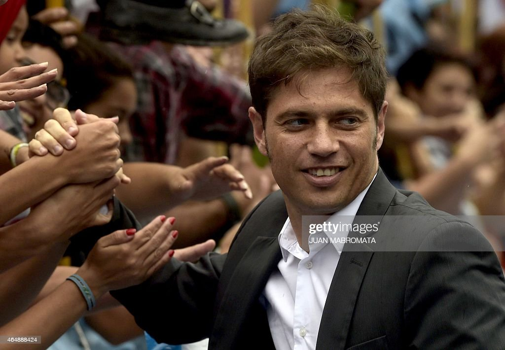 Argentine Economy Minister <a gi-track='captionPersonalityLinkClicked' href=/galleries/search?phrase=Axel+Kicillof&family=editorial&specificpeople=9189054 ng-click='$event.stopPropagation()'>Axel Kicillof</a> is greeted bysupporters after Argentine President Cristina Fernandez de Kirchner delivered a speech during the inauguration of the 133th period of ordinary sessions at the Congress in Buenos Aires, Argentina on March 1, 2015.