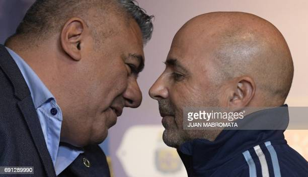 Argentine Football Association president Claudio Tapia and Argentine football team's new coach Jorge Sampaoli attend a press conference in Ezeiza...