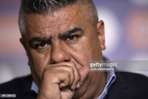 Argentine football association president Claudio Tapia gestures while presenting the Argentine football team's new coach Jorge Sampaoli during a...