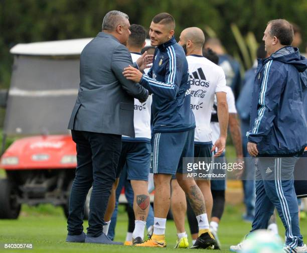 Argentine Football Association president Claudio Tapia greets forward Mauro Icardi during a training session in Ezeiza Buenos Aires on August 28 2017...