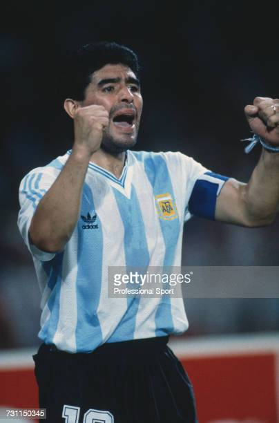 Argentine football captain Diego Maradona raises his arms in the air during the semi final match between Argentina and Italy in the 1990 FIFA World...