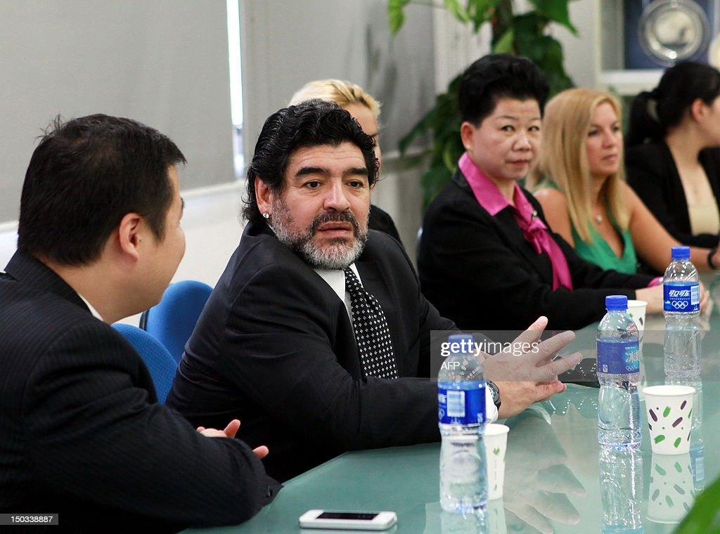 Argentine football great Diego Maradona talks during a meeting with Wei Di, head of the Chinese Football Association, in Beijing on August 16, 2012. Maradona is in Beijing for an eight-day charity tour, while Chinese state media reported that the Argentine football great wants to coach in China, where clubs are spending big bucks to lure international names. CHINA
