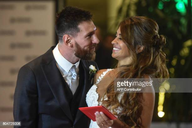 Argentine football star Lionel Messi and bride Antonella Roccuzzo pose for photographers just after their wedding at the City Centre Complex in...