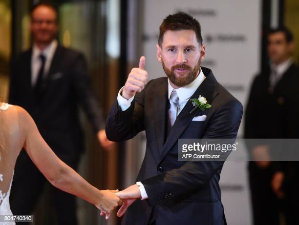 Argentine football star Lionel Messi gives his thumb up just after his wedding at the City Centre Complex in Rosario Santa Fe province Argentina on...