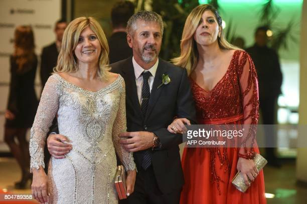 Argentine football star Lionel Messi's parents Jorge Horacio Messi and Celia Maria Cuccittini and his sister Maria Sol Messi pose after Messi's...